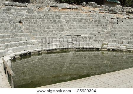 Ruins of ancient Greek/Roman theatre at archeological siete of Butrint south Albania