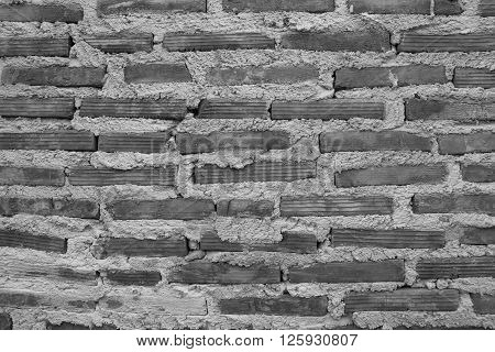 Brick wall placed on a vertical stick with a plaster waiting to shetland.