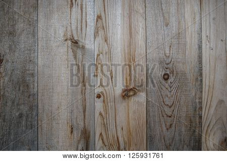 Texture background - old wood fence. Boards darkened in the sun.