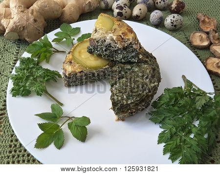 Goutweed squash with mushrooms omelet on plate, Cooking with ginger, wild plants and quail eggs
