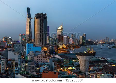 HO CHI MINH CITY, VIETNAM - JAN 15, 2016: Top view of Saigon River at night time. Saigon River (the length of 256 kilometers) is most important to Ho Chi Minh City as it is the main water supply.