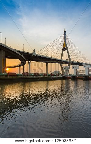 Suspension Bridge over watergate over Chao Phraya River during sunset, Bangkok Thailand