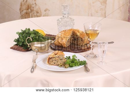 puff pastry pie with chicken and mushrooms and the brandy in the glass