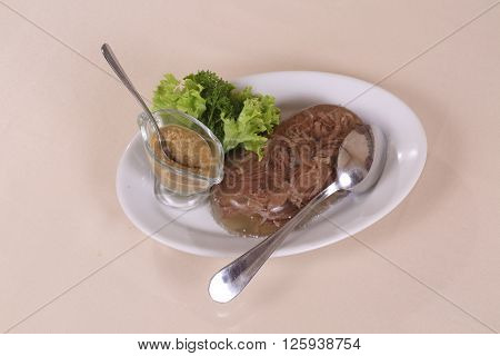 meat in aspic served with mustard jelly