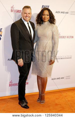 Garcelle Beauvais and Ross Mathews at the 23rd Annual Race To Erase MS Gala held at the Beverly Hilton Hotel in Beverly Hills, USA on April 15, 2016.