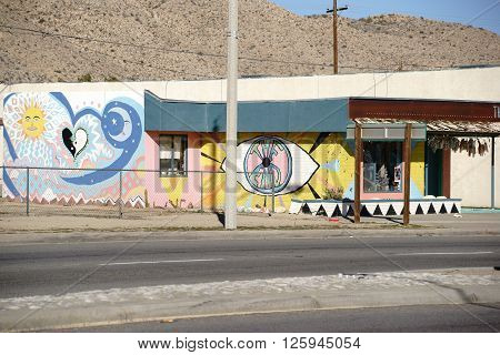 YUCCA VALLEY, UNITED STATES - DECEMBER 24: The brightly painted facade of an old vintage shop in the desert southwest of California on December 24 2015 in Yucca Valley.