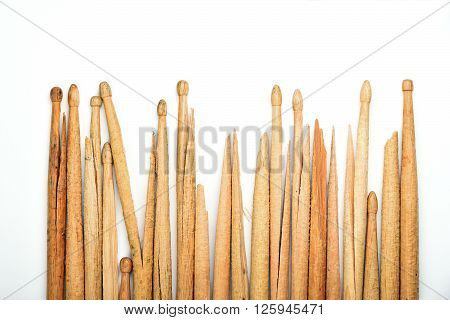 Broken Old Wooden Drumsticks Over White