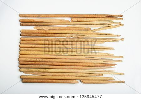 Broken Old Wooden Drumsticks Over Gray