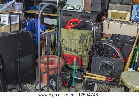 Junk filled corner of storage garage.