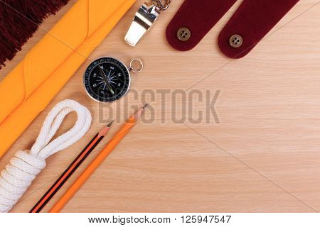 Orderliness White Scout Rope, Scarf, Whistle, Pencil, Compass And Blank Shoulder Epaulette On Wooden