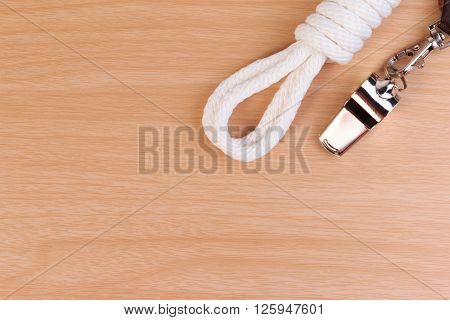 Metal Whistle, Yellow Scout Scarf And Scout Rope On Wooden Background.