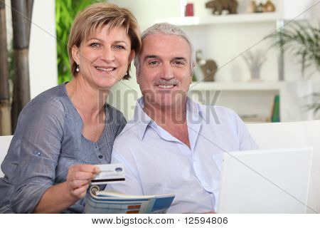 Senior couple making online purchases