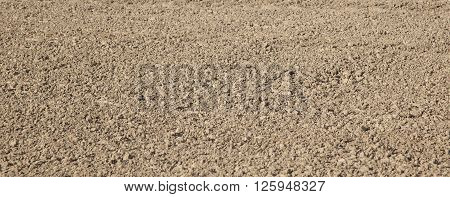 pattern of fresh plowed field gives a harmonic background