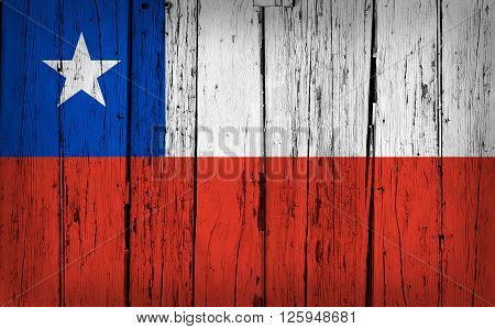 Chile state grunge wood background with Chilean flag painted on aged wooden wall.