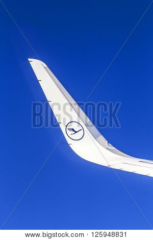 Left Wing Of Lufthansa Aircraft In Blue Sky