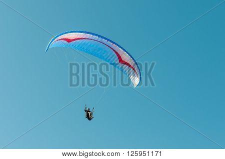 PORT ELIZABETH SOUTH AFRICA - FEBRUARY 27 2016: A paraglider in the air at Beachview near Port Elizabeth