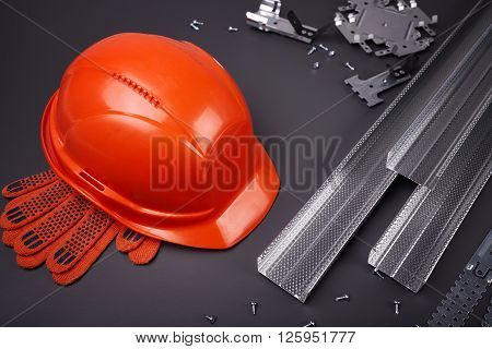 Construction helmet, profile for plasterboard, fixing plasterboard, set of building profiles, building materials, steel profiles for repair, construction works, screws for construction