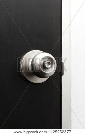 Background series : Stainless steel door knob on dark wooden door