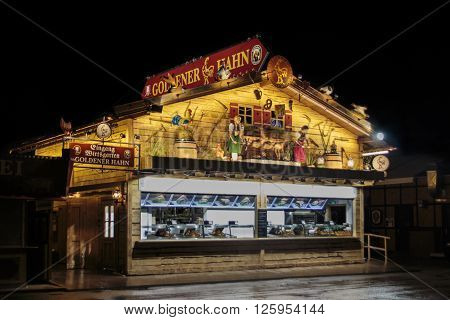 MUNICH, GERMANY - SEPTEMBER 18, 2015: Nightshot of the Golderner Hahn stall on Theresienwiese