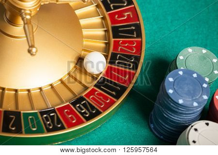 casino roulette wheel with the ball on number 7