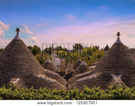 Alberobello: skyline of monumental Trulli village. ITALY,APULIA.Alberobello is a UNESCO World Heritage. Conical rooftop of trulli:It is a false dome built  with dry overlapping stones, whitewashed base and cone-shaped roof with pinnacles of various shapes