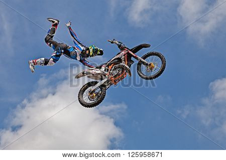 VOLTANA DI LUGO (RA) ITALY - APRIL 10: freestyle motocross show; a stunt biker make a jump and performing an acrobatic figure in flight during the motorcycle rally