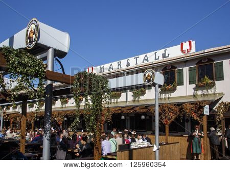 MUNICH, GERMANY - OCTOBER 02: Outside the Marstall beer tent on Theresienwiese with people celebrating Octoberfest in the beer garden