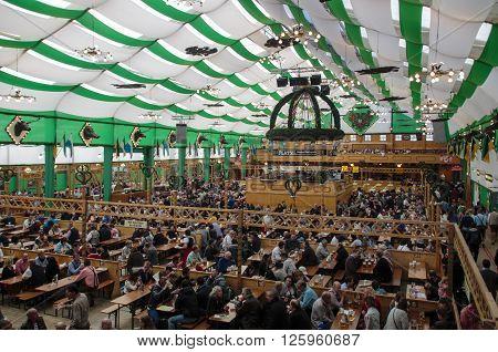 MUNICH, GERMANY - OCTOBER 02, 2015: Inside the Armbrustschuetzenzelt with people celebrating Oktoberfest