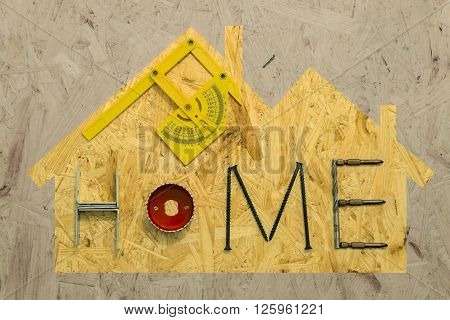 Silhouette of a suburbian house with mounting materials at OSB sheet