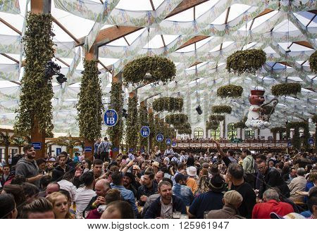 MUNICH, GERMANY - OCTOBER 02: Inside the Hofbraeu beer tent at Oktoberfest on Theresienwiese with people celebrating Oktoberfest