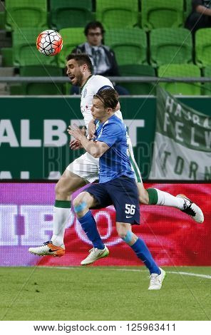 BUDAPEST HUNGARY - APRIL 16 2016: Daniel Bode of Ferencvaros (l) battles for the ball in the air with Daniel Gera of MTK Budapest during Ferencvaros - MTK Budapest OTP Bank League football match at Groupama Arena.