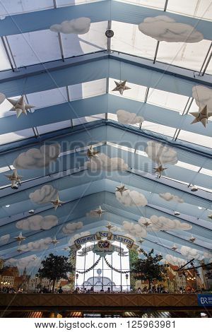 MUNICH, GERMANY - OCTOBER 02, 2015: Inside the Hacker Festzelt (Himmel der Bayern) at Oktoberfest with its lovely decoration of the roof and the surrounding walls