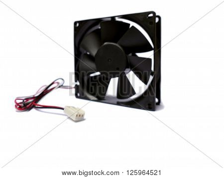 Computer fan plug with fan faded in background isolated on white