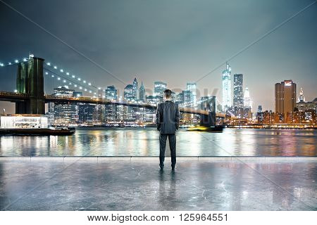 Rearview of businessman in illuminated night city