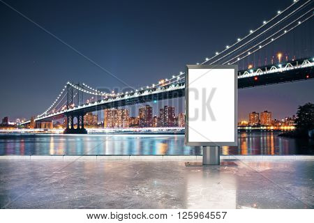 Blank ad stand in city at night. Mock up 3D Rendering