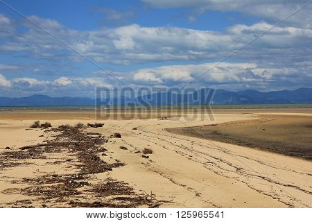 Sandy beach in the Abel Tasman National Park. Pastel colored landscape in New Zealand. Nature background.