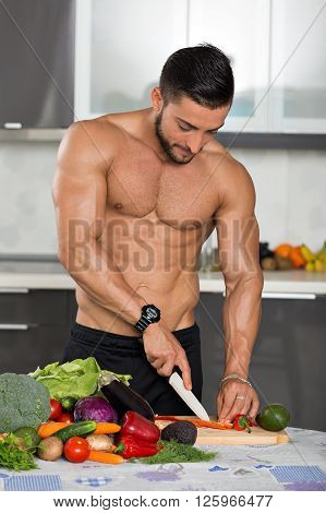 Young Fit Bodybuilder In The Kitchen