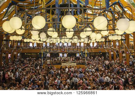 MUNICH, GERMANY - OCTOBER 02, 2015: Inside the Braeurosl beer tent with people celebrating Oktoberfest