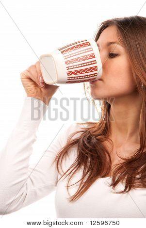 Brunette Woman Drinking Tea Coffee From Mug