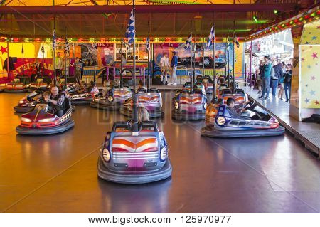 MUNICH, GERMANY - OCTOBER 02: Bumper car rides during Oktoberfest attract many people and is always fun