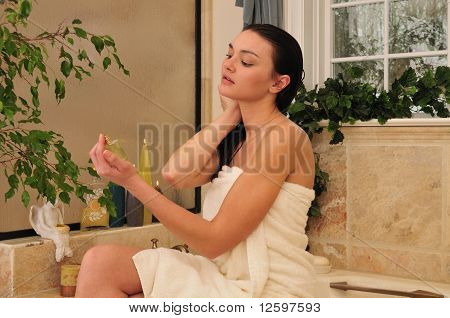 Woman Using Perfum In The Bathroom