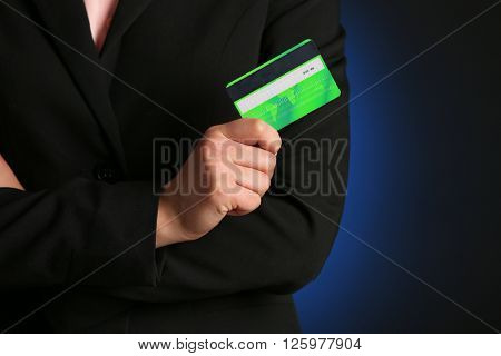 Businesswoman holding a credit card.