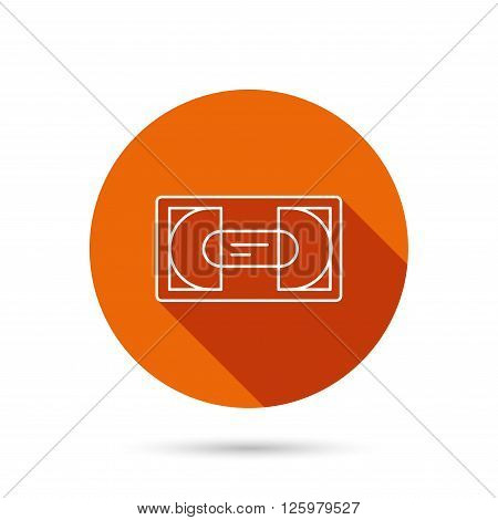 Video cassette icon. VHS tape sign. Round orange web button with shadow.