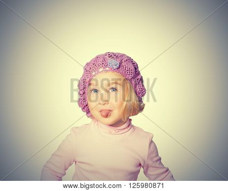Cheerful Little Girl In A Beret Shows Language.