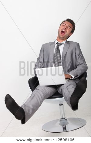 Businessman in front of  a laptop computer
