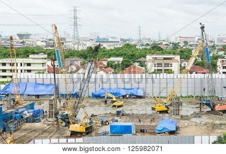 Drilling machines for foundation pilling at a construction site
