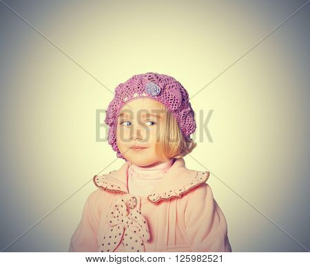 Little Girl In A Pink Coat And Beret