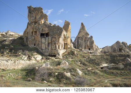 Freakish rocks with remnants of ancient dwellings of christians in the surrounding area of Goreme. Cappadocia, Turkey