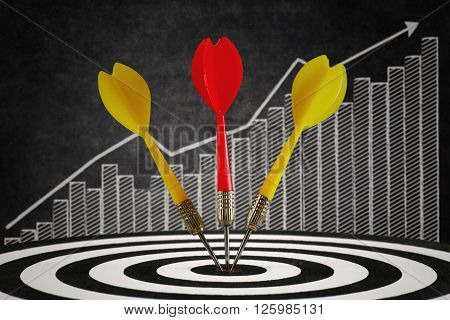 Three darts on the center of a dart board with graph background