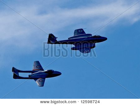 Historical jet fighter aircraft in fly-past